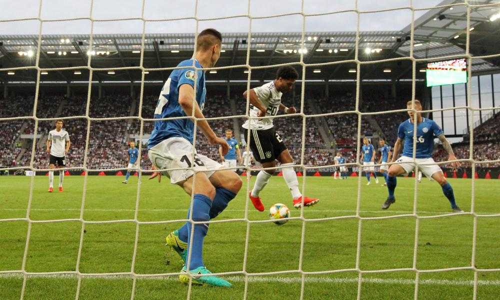 Serge Gnabry of Germany scores his team's second goal.