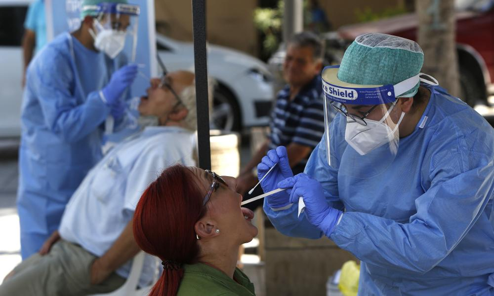 Health workers carry out coronavirus tests on people in the southern coastal city of Limassol in Cyprus.