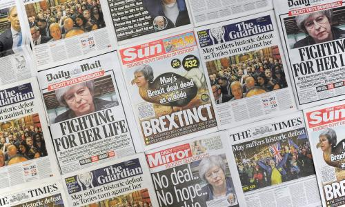 "An arrangement of daily newspapers photographed in London on January 16, 2019 shows front pages reporting on the UK parliament's rejection of the government's Brexit deal. Prime Minister Theresa May was left ""crushed"" and ""humiliated"", Britain's newspapers said on January 16 as they raked over the fallout from parliament's huge rejection of her EU divorce deal."