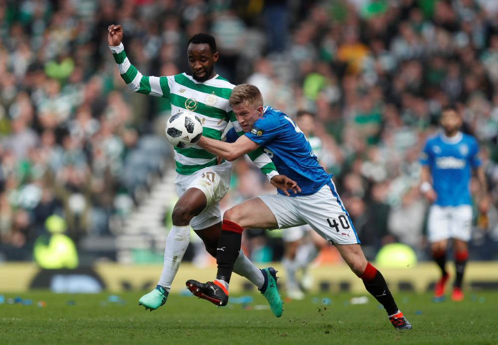 Dembele holds off McCrorie.