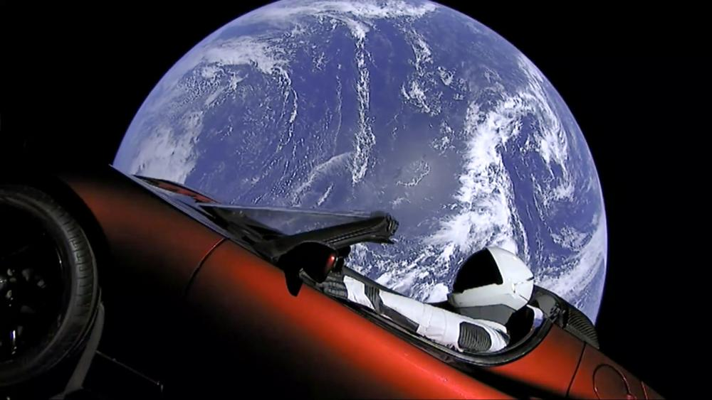 spacesuit in Elon Musk's red Tesla sports car which was launched into space