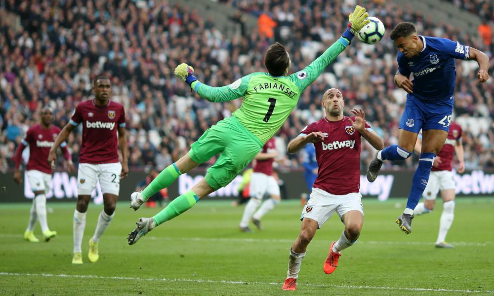 Lukasz Fabianski of West Ham United reaches for the ball as Dominic Calvert-Lewin of Everton jumps for a header.