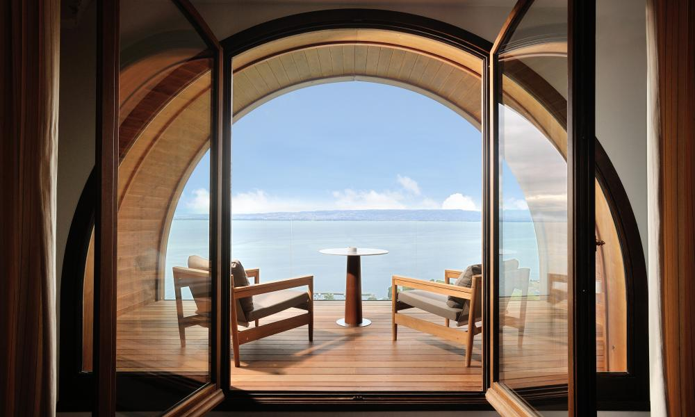 Through the arched window: a balcony at the Hotel Royal Evian.
