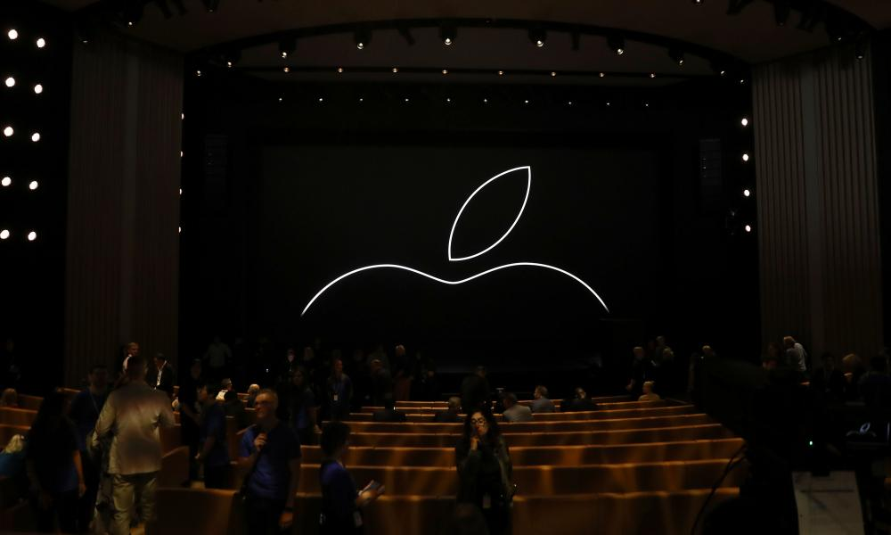 Attendees start to fill in seats prior to an Apple event at the Steve Jobs Theater.