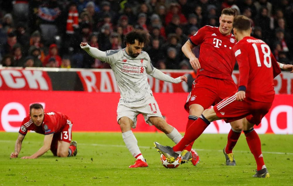 Sule blocks the shot from Salah.