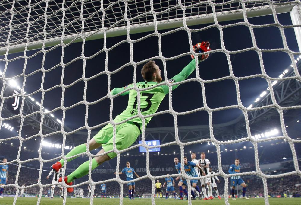 Atletico goalkeeper Jan Oblak fails to stop Juventus' Cristiano Ronaldo's second goal.