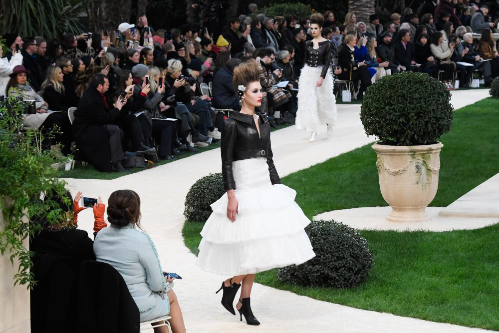 Models walk the runway during the finale of the Chanel spring/summer 2019 show