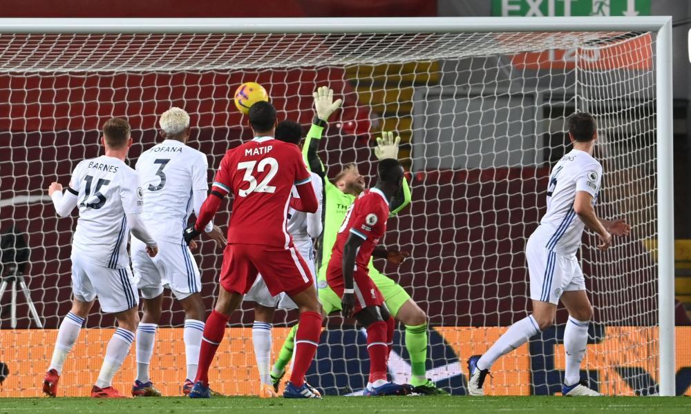Leicester City's Northern Irish defender Jonny Evans (R) scores an own goal.