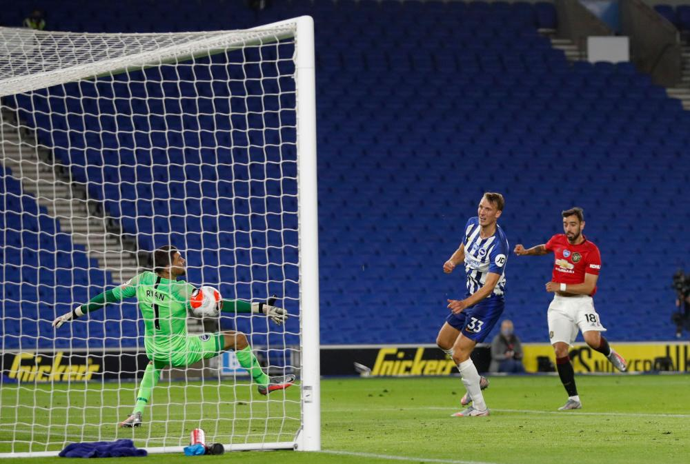 Manchester United's Bruno Fernandes volleys in the third.