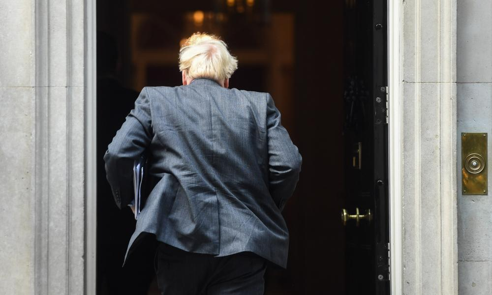 Boris Johnson returning to No 10 after delivering his speech to the Commons on coronavirus.