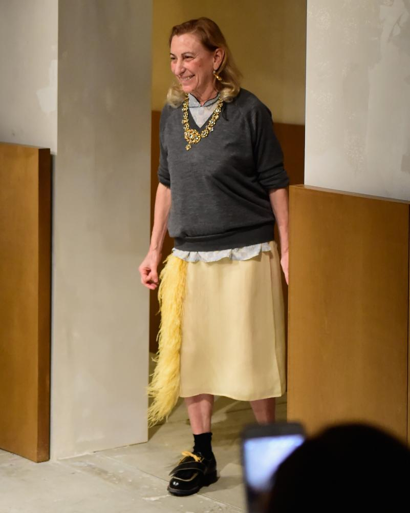 Miuccia Prada in her V-neck, Milan men's fashion week, 2017.