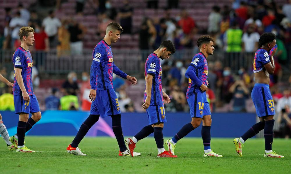 Dejected Barcelona players get their trudge on after losing to Bayern again.