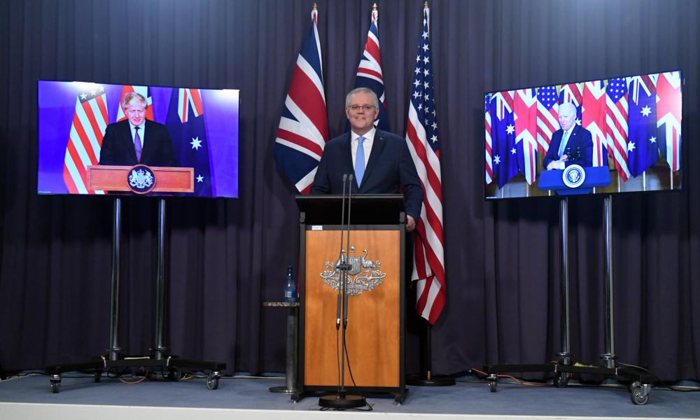 Scott Morrison appears between Boris Johnson and Joe Biden at a joint press conference earlier today.
