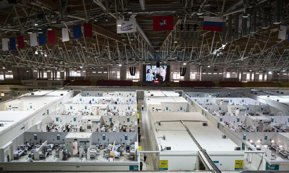 Medical workers and patients are seen in the treatment hall of a temporary hospital for coronavirus patients in the Krylatskoye Ice Palace in Moscow, Russia, Wednesday, Nov. 18, 2020.