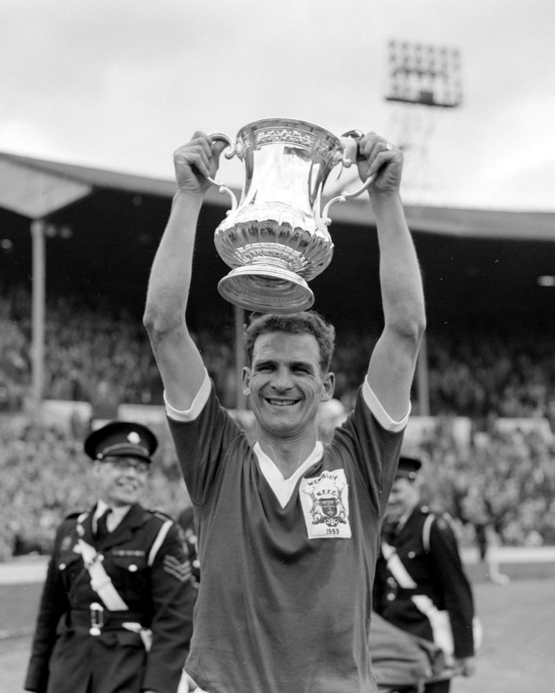 Nottingham Forest captain Jack Burkitt lifts the original FA Cup after the 2-1 victory over Luton Town at Wembley in the 1959 final