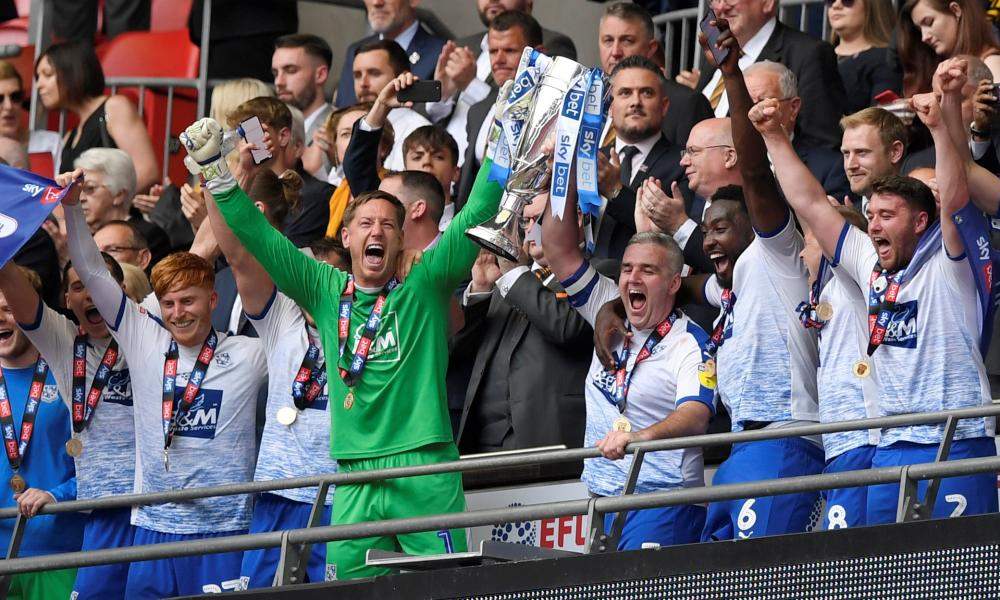 Tranmere Rovers' Scott Davieson and team mates celebrate winning the League Two Play-Off Final