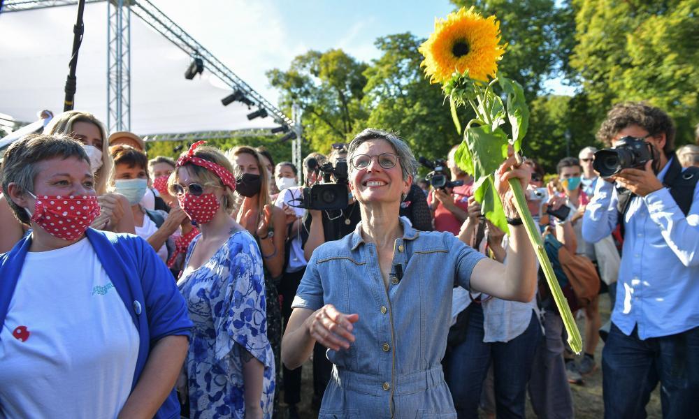 Sandrine Rousseau holding a sunflower