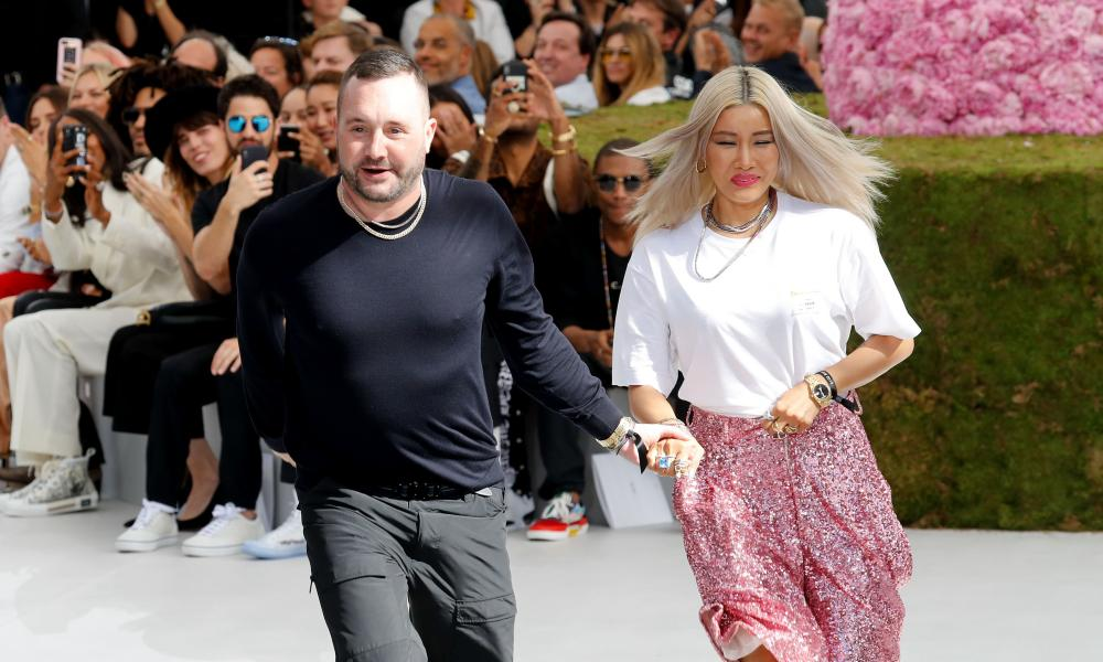 Jones acknowledges the audience at the end of his first Dior show.