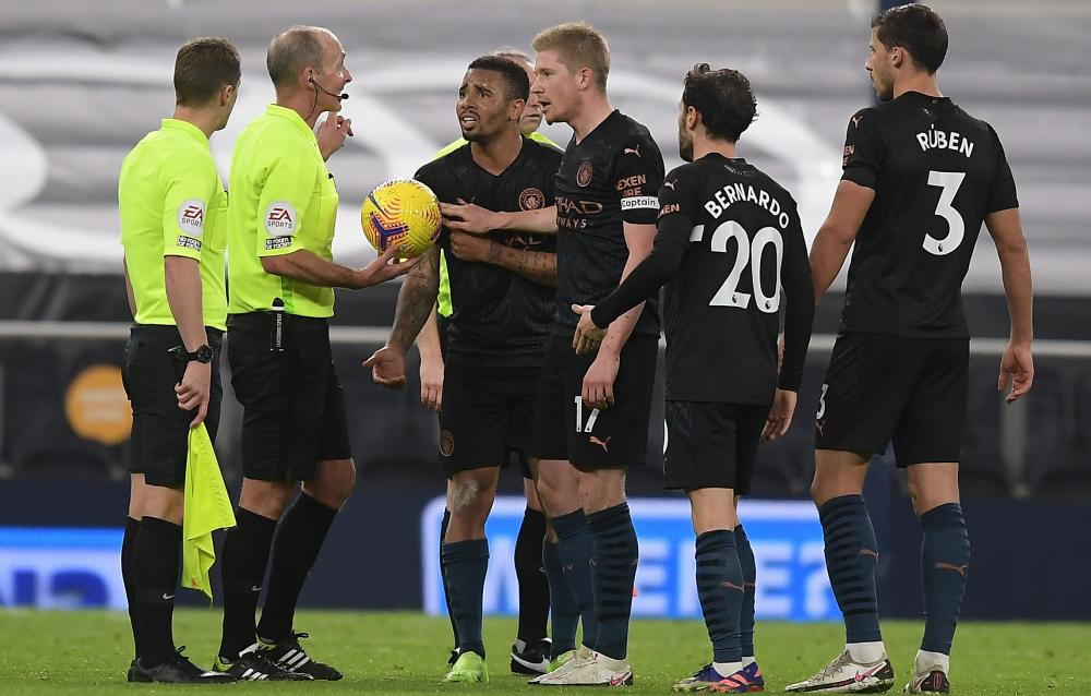 Gabriel Jesus leads the protests after the ball was ruled to have brushed his arm before he set up Aymeric Laporte
