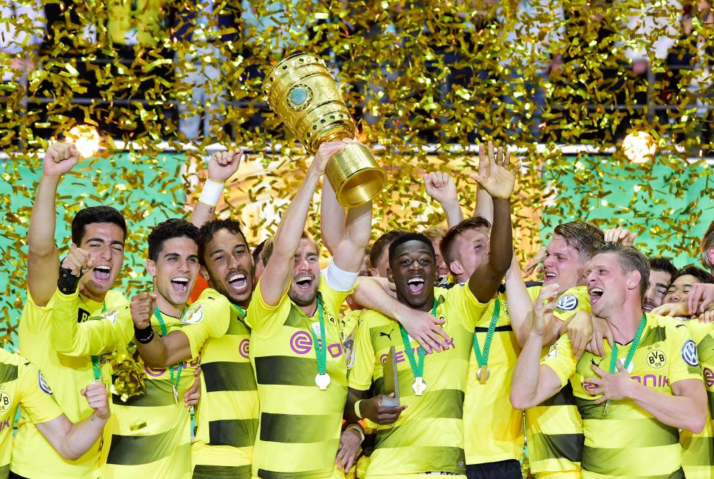 Ousmane Dembélé and team-mates celebrate after winning the German Cup final.