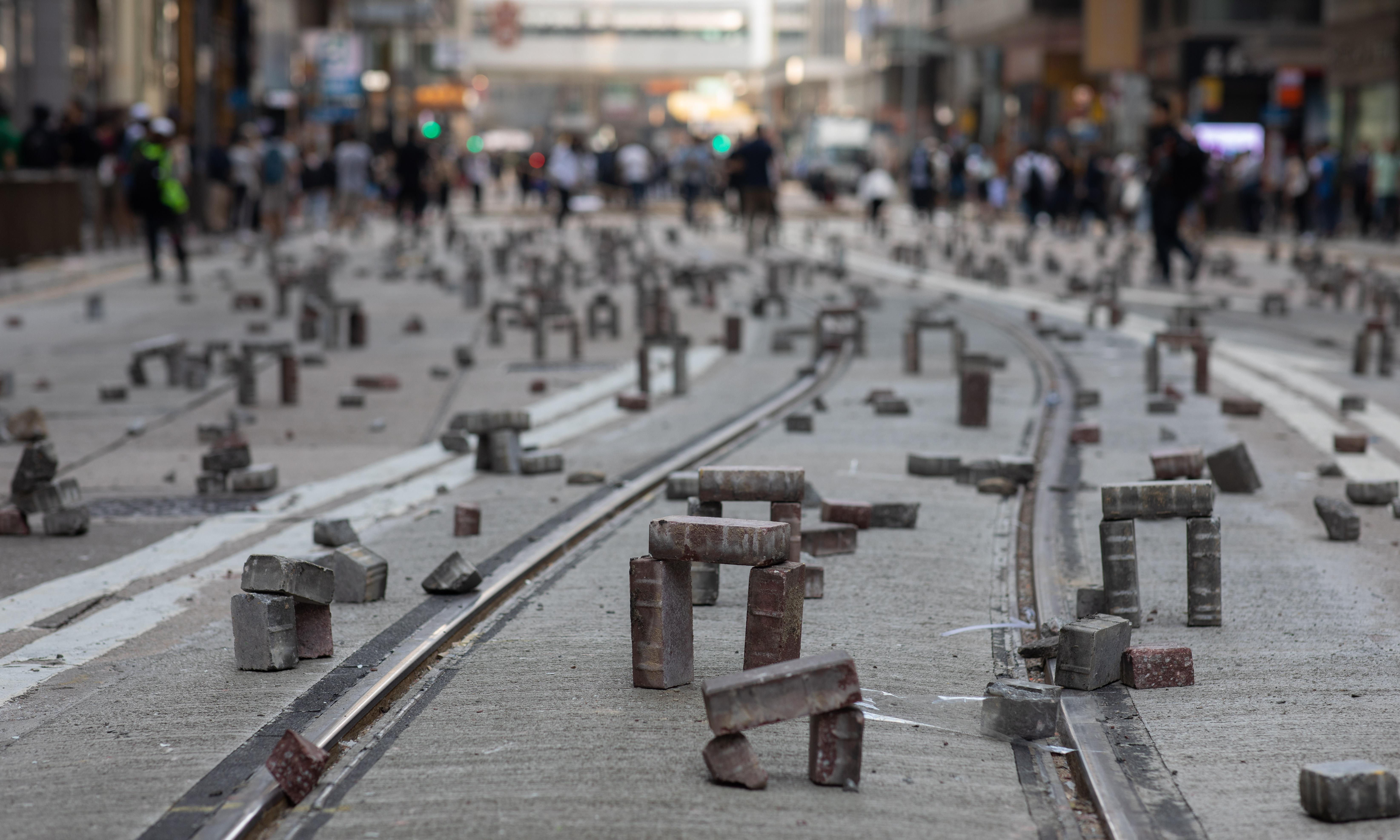 'Mini Stonehenges': Hong Kong protesters take on police, one brick at a time