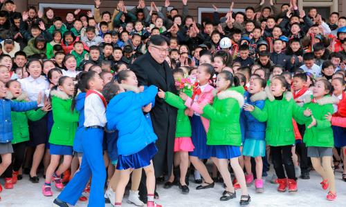 Children greet North Korean leader Kim Jong-un during his visit to Samjiyon county, the birthplace of his father, Kim Jong-il