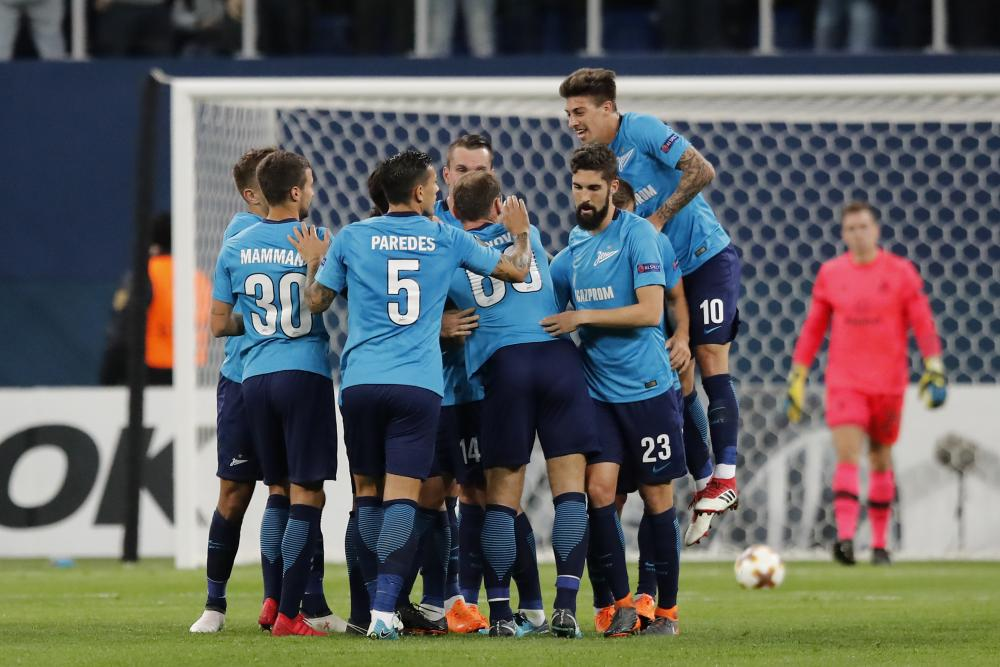 Zenit players surround Daler Kuzyayev after he scored his side's second.