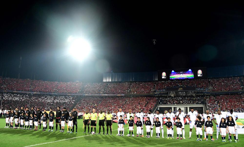 The players line up on the pitch.