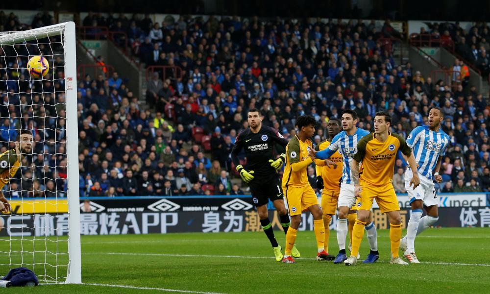 Huddersfield Town's Mathias Jorgensen heads home in the first minute.