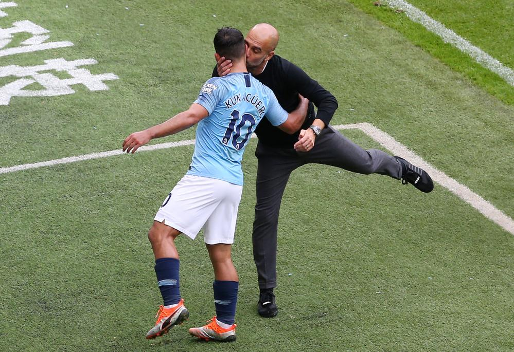 August 19: Manchester City's manager Pep Guardiola congratulates Sergio Aguero with a kiss on the cheek during their match against Huddersfield Town.