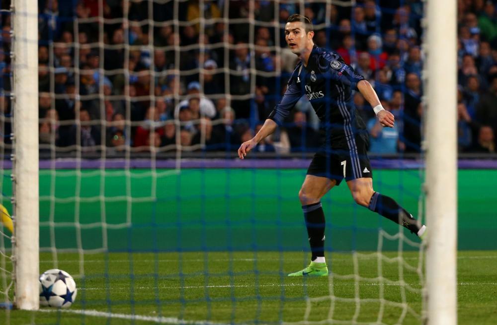 Real Madrid's Cristiano Ronaldo hits the post