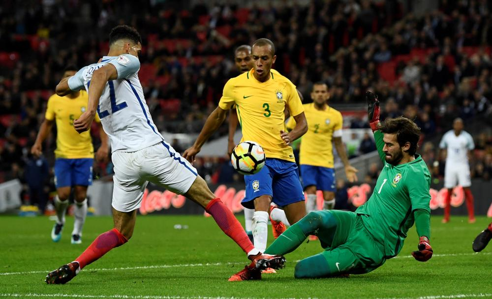 Dominic Solanke is denied by Alisson and Miranda.