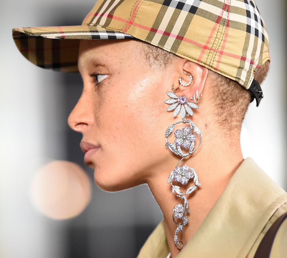 Adwoa Aboah in a Burberry cap on the catwalk.