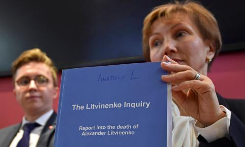 Marina Litvinenko, (R) widow of murdered ex-KGB agent Alexander Litvinenko, poses with a copy of The Litvinenko Inquiry Report with her son Anatoly (L) during a news conference in London, Britain, January 21, 2016.