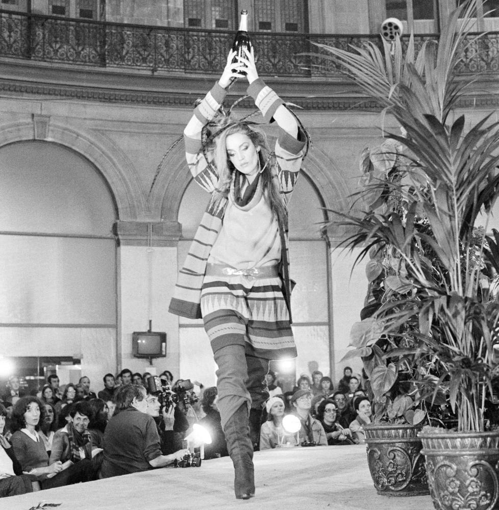 Jerry Hall wears ready-to-wear women's fashions by Japanese designer Kenzo Takada in 1977.