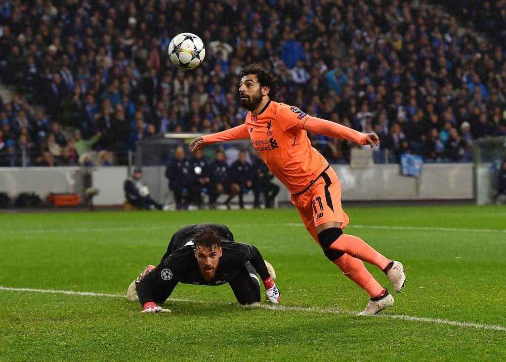 Salah takes the ball around Jose Sa to score.