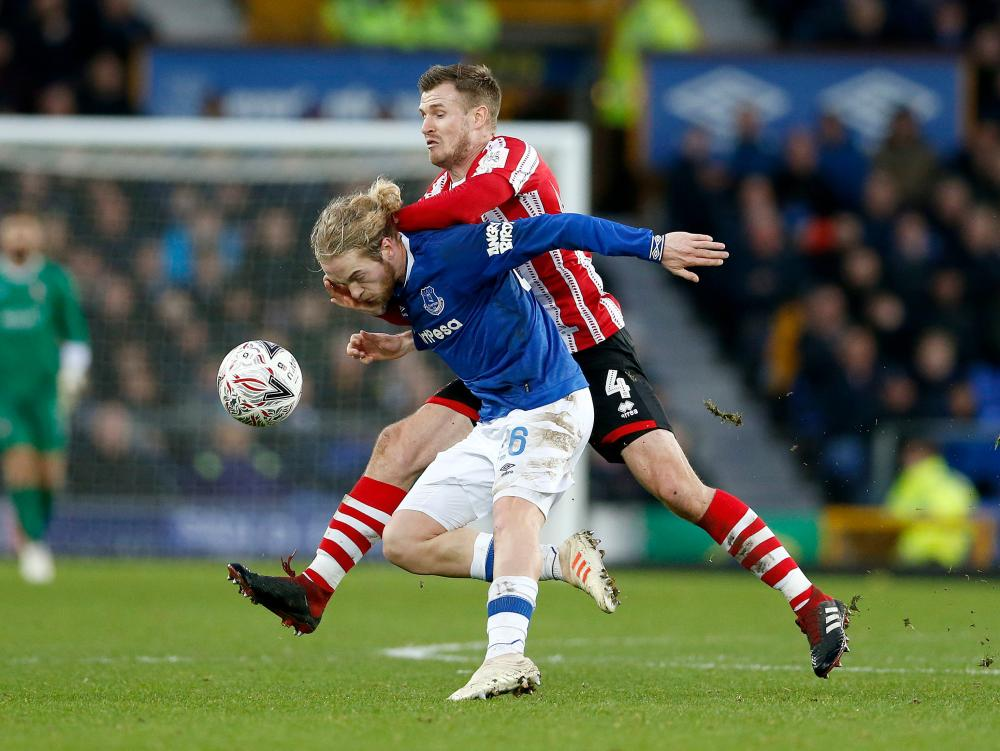 Tom Davies is fouled by Lincoln's Michael O'Connor