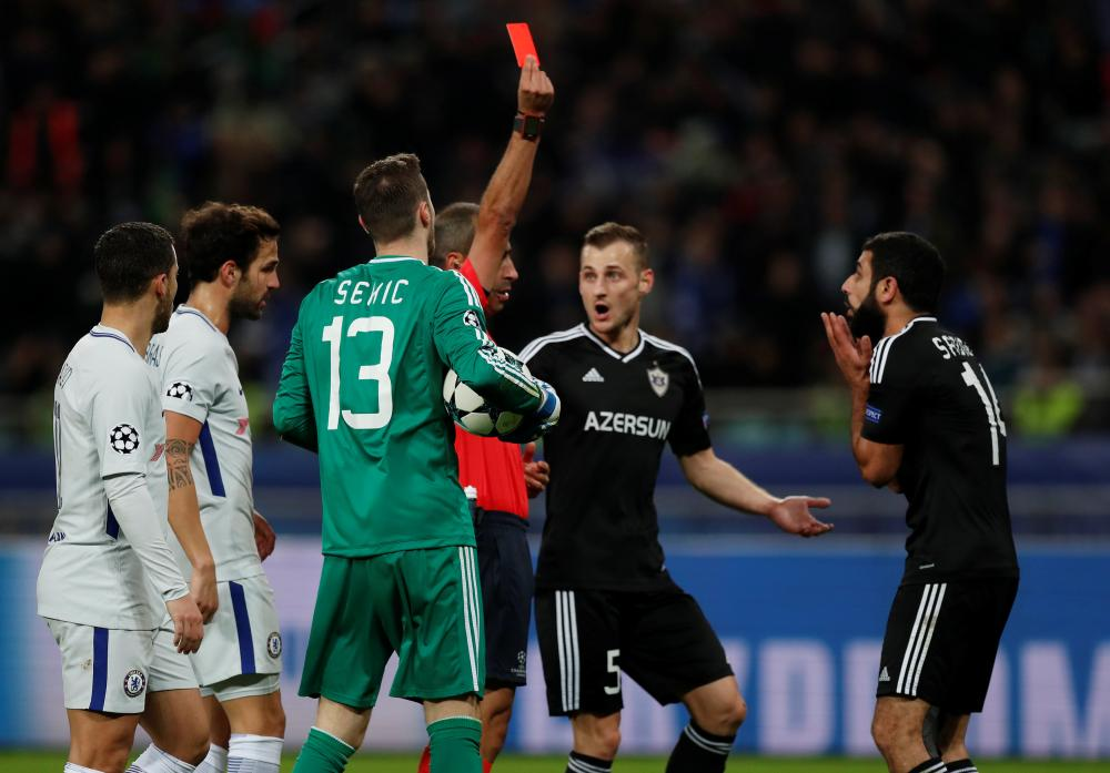 Qarabag's Rashad Sadygov is shown a red card by referee Manuel De Sousa.