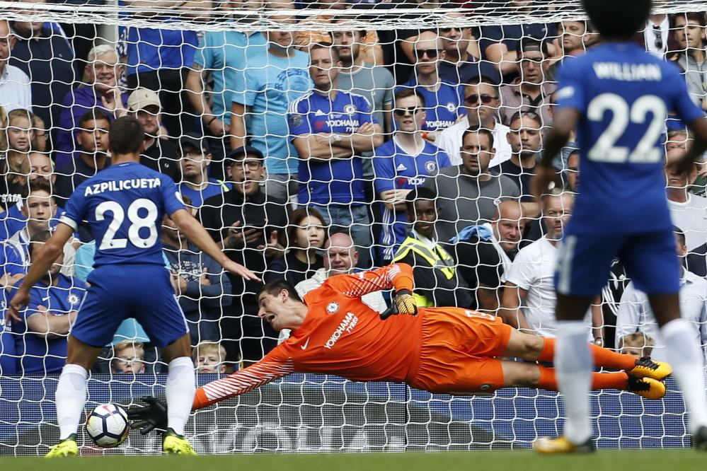 Thibaut Courtois cannot keep out Vokes' shot.