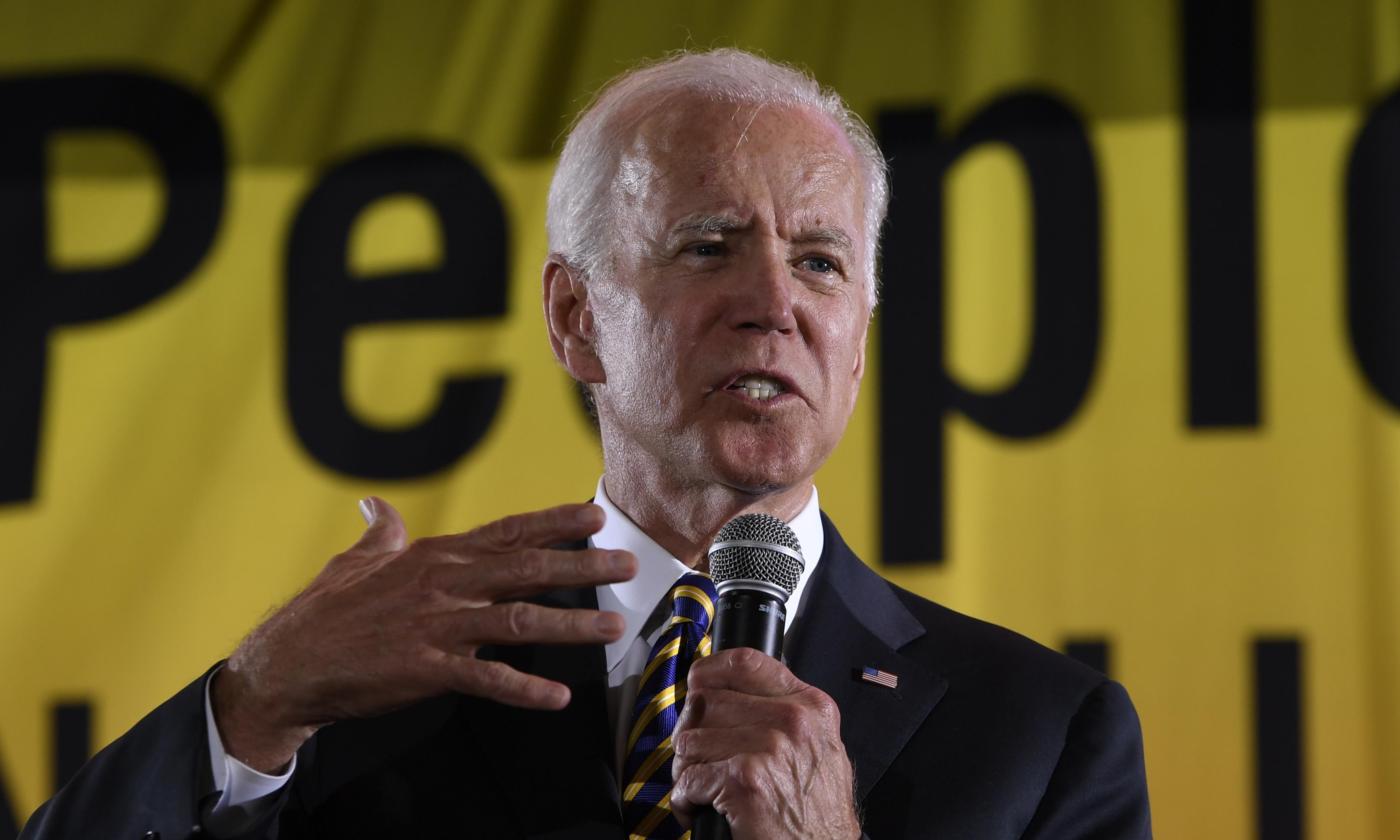 Biden spars with Warren and Sanders at first event facing rival Democrats