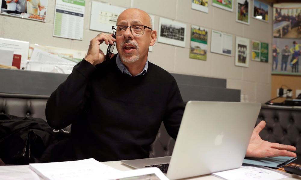 Haringey Borough's chairman, Aki Achillea, making plans in the boardroom.