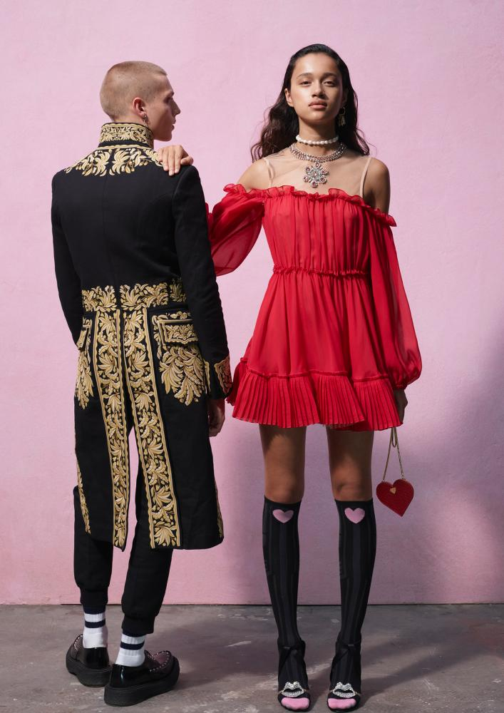Embroidered coats and knee-high socks … items from the collaboration.