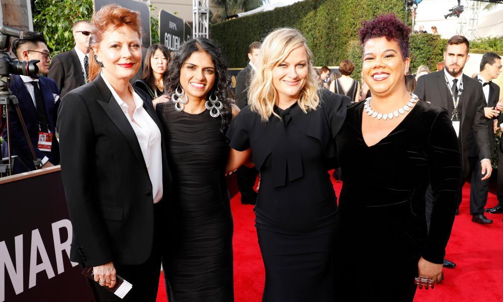 In this together: actor Susan Sarandon, activist Saru Jayaraman, actor Amy Poehler and activist Rosa Clemente arrive at the 2018 Golden Globe awards.