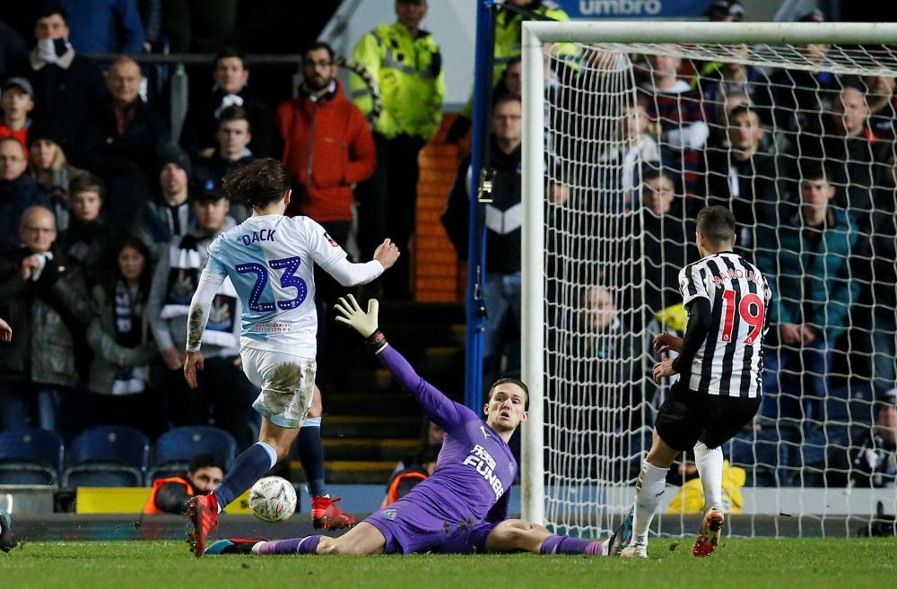 Blackburn Rovers' Bradley Dack misses a chance to score.