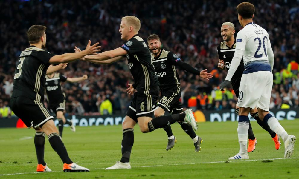 Ajax's Donny van de Beek celebrates with teammates after scoring.
