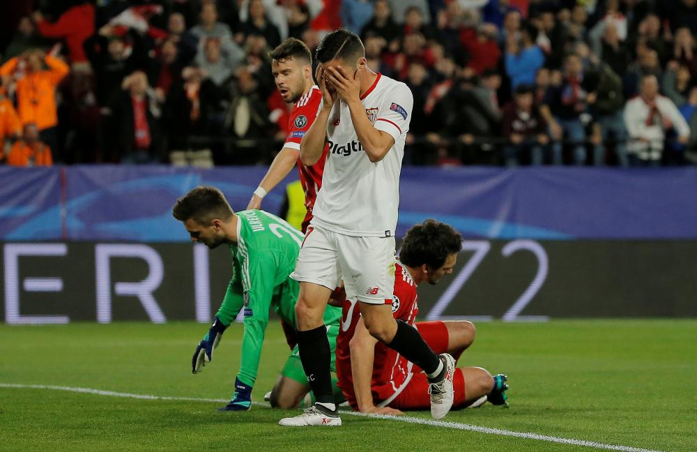 Sevilla's Pablo Sarabia reacts after missing a good chance.