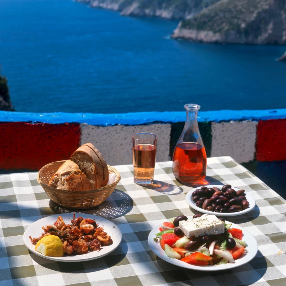 Traditional Greek salad on a table at an outdoor taverna.