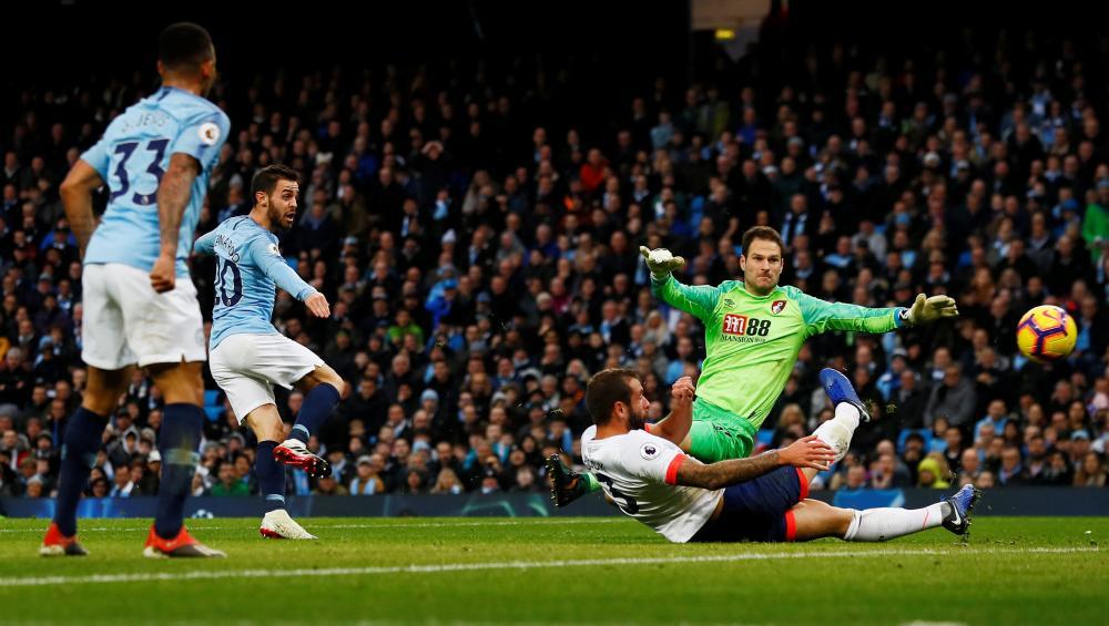 Bernardo Silva scores after Sane's shot was saved by Begovic.