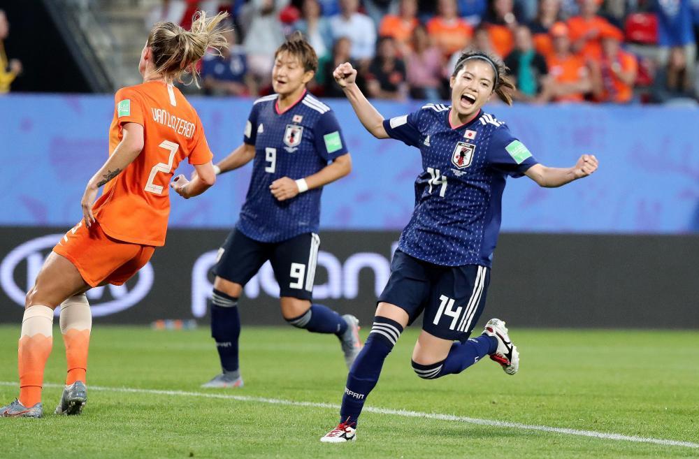 Japan's Yui Hasegawa celebrates scoring their first goal.