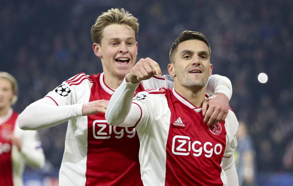 Dusan Tadic celebrates his second goal with Frenkie de Jong during Wednesday's draw with Bayern.